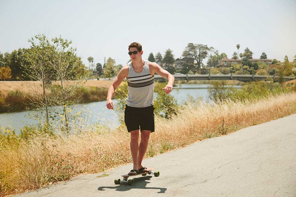 Young man skateboarding along the Santa Cruz Riverwalk