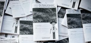 Black and white photo of a Watershed Ranger journal with a picture of erosion.